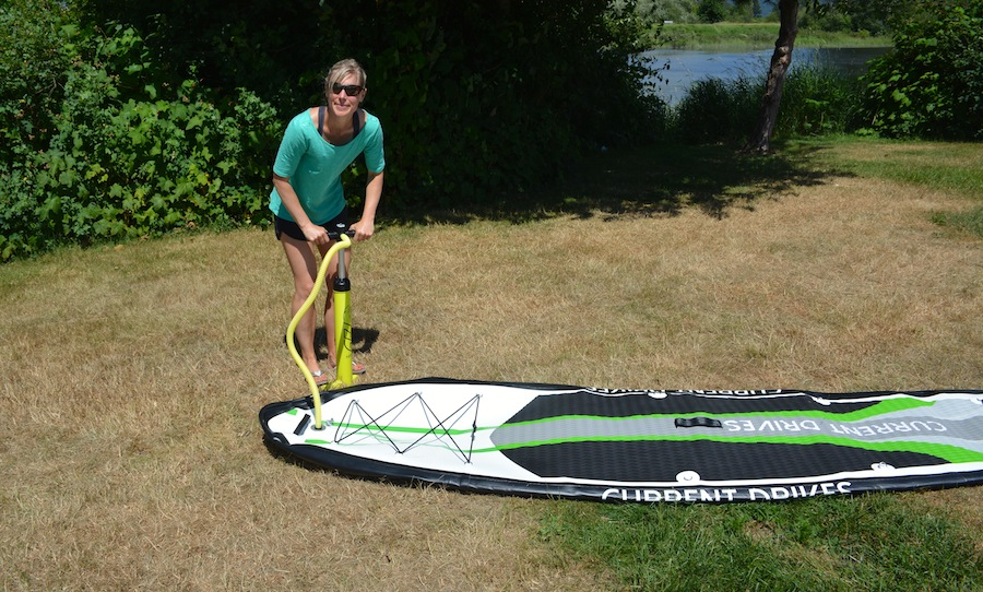 hand pumping the Current Drives inflatale SUP
