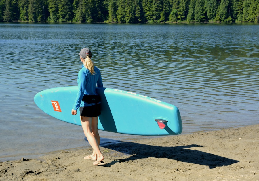 carrying the Red Paddle Co Sport inflatable SUP