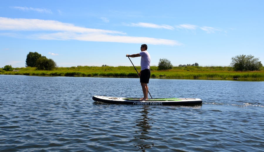 paddling the current drives huey inflatable sup