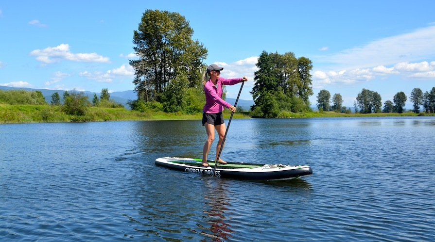 stand-up paddling on the current drives Huey ISUP