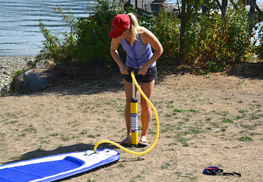 using hand pump to inflate inflatable stand-up paddleboard