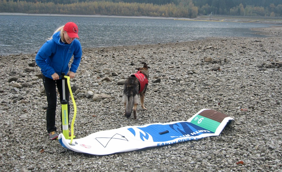 inflating Earth River SUP with hand pump