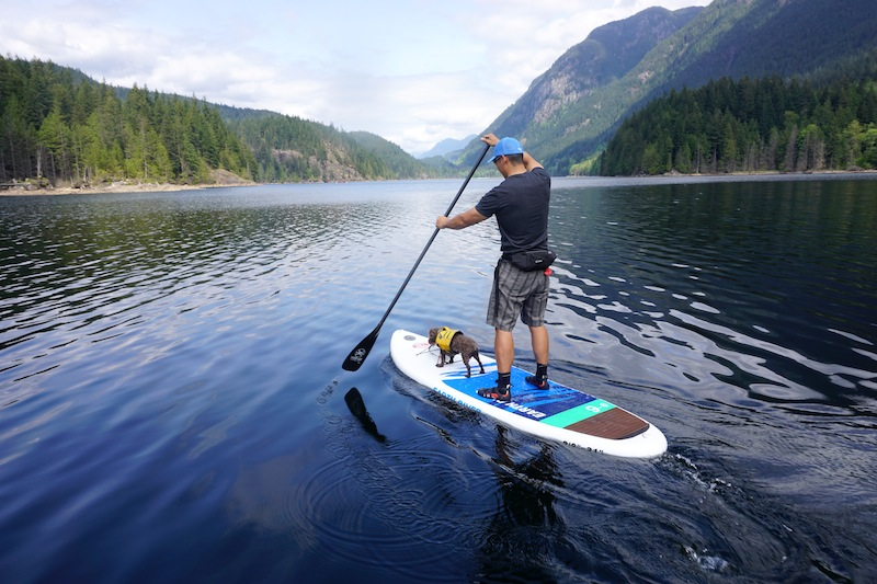 Man riding kayak on the body of water
