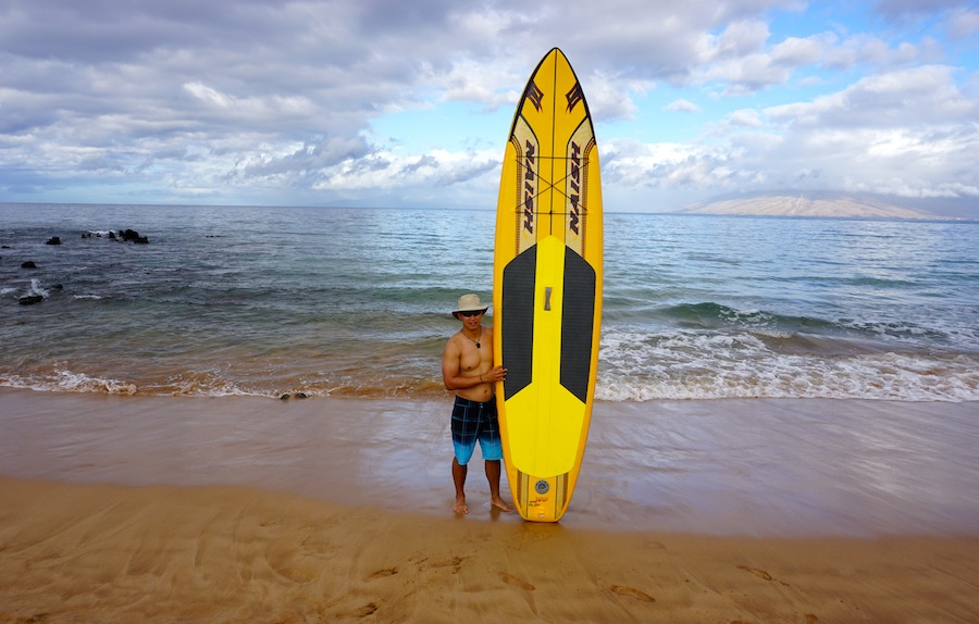 holding the Naish Glide Air ISUP Maui