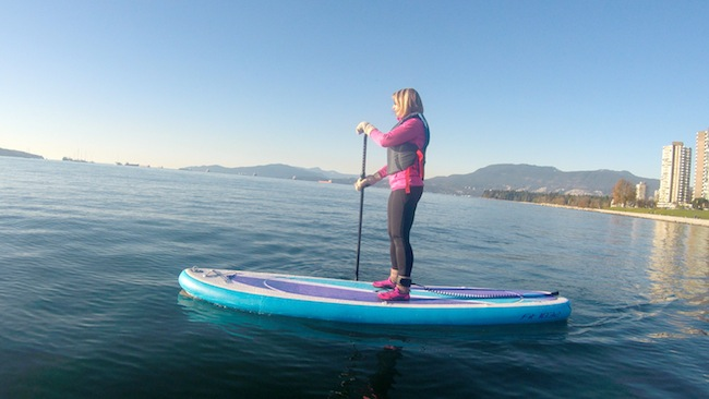 paddling the Airhead Fit inflatable SUP in Vancouver off Kits Beach