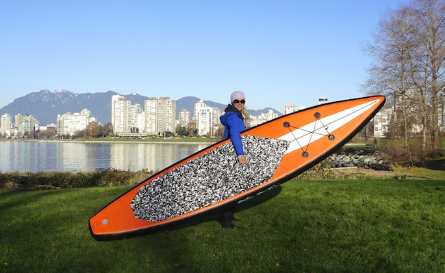 "carrying the 12'6"" Tantrum Tow Ropes board"