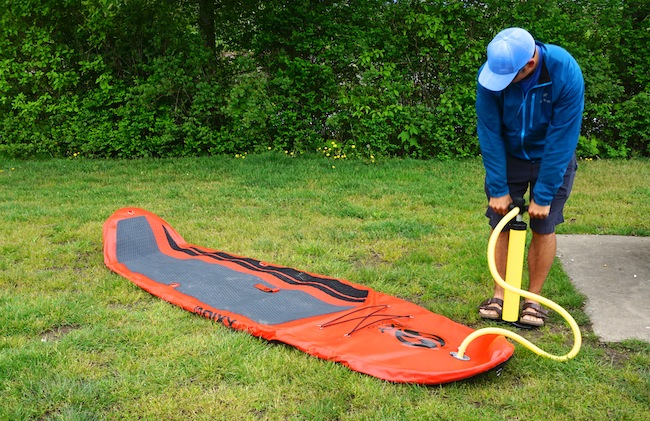inflating paddle board