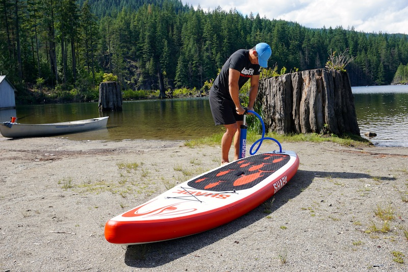 inflating Shark paddleboard