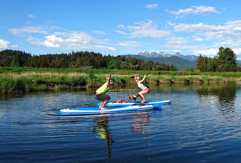 squats on paddle board SUP fitness