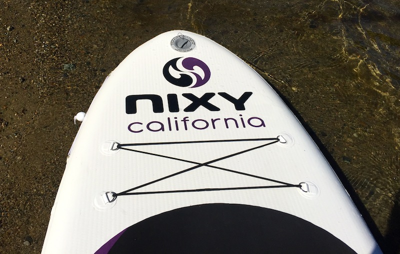 Nixy California bungee cords on paddle board