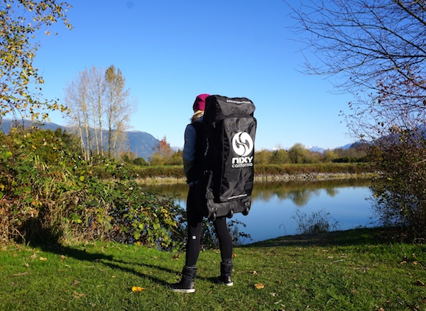 carrying the Nixy backpack inflatable paddle board